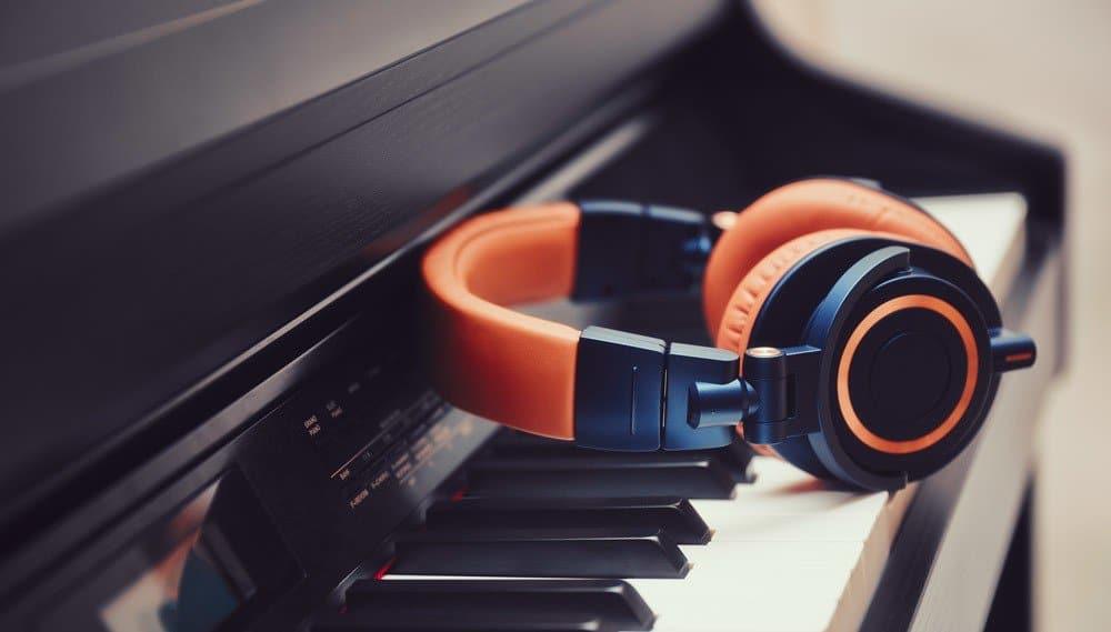 Piano With Orange Headphones