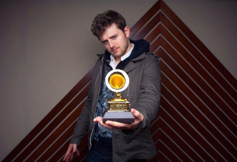 An artist shows off Grammy award